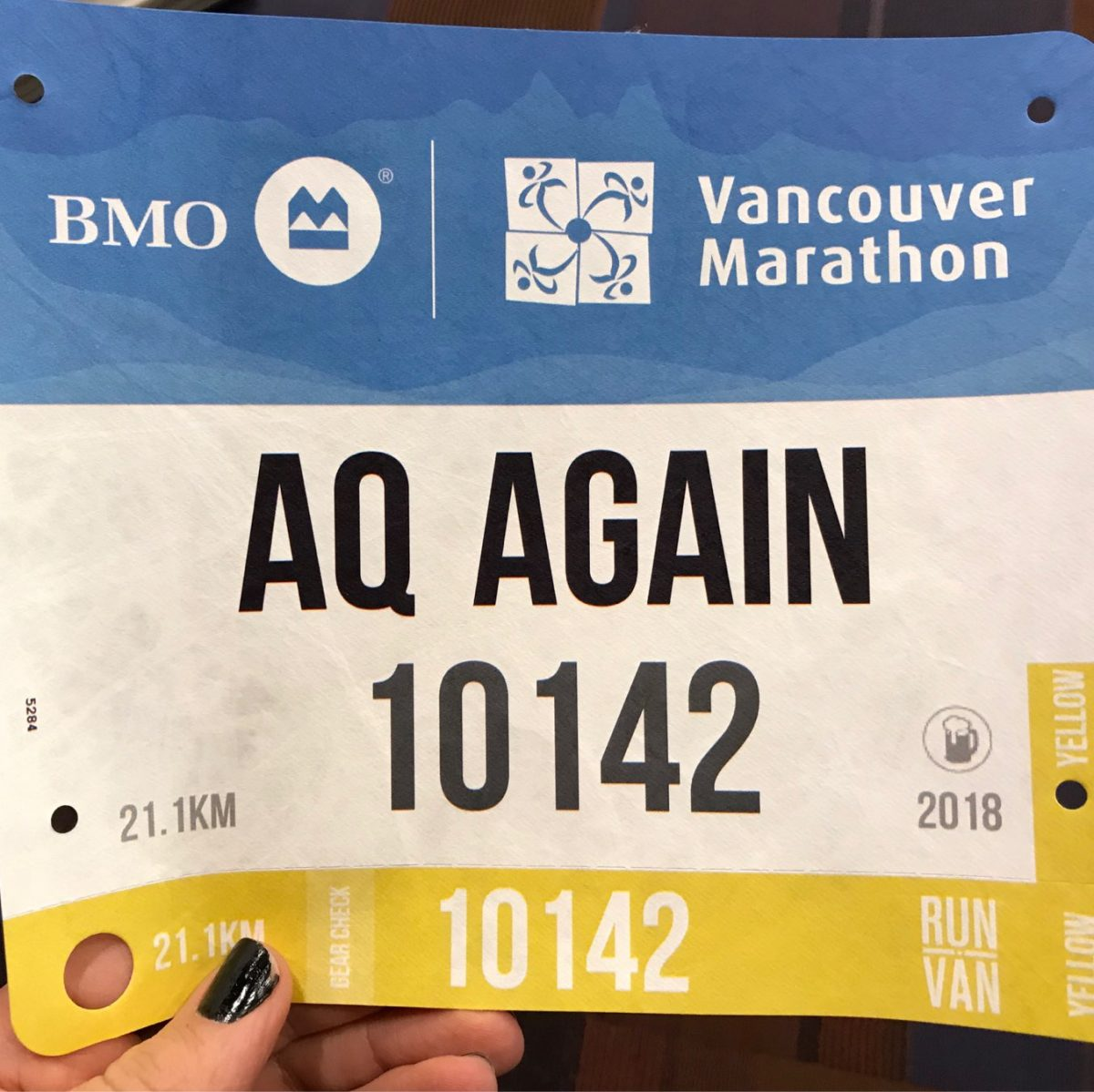 A blue, white and yellow race bib with the name